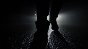stock-footage-criminal-walking-in-dark-night-feet-walking-close-up-silhouette-shadow-background-mystical-mood