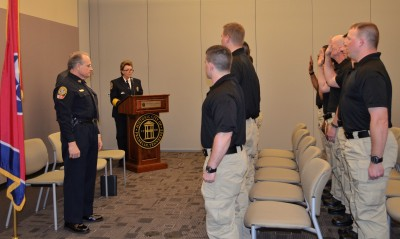 Chief Faulkner administers oath to new recruits