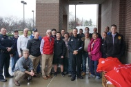 Rotary members & Franklin Police Officers with the Lewis'